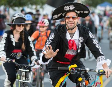 Man dressed in costume riding a bicycle