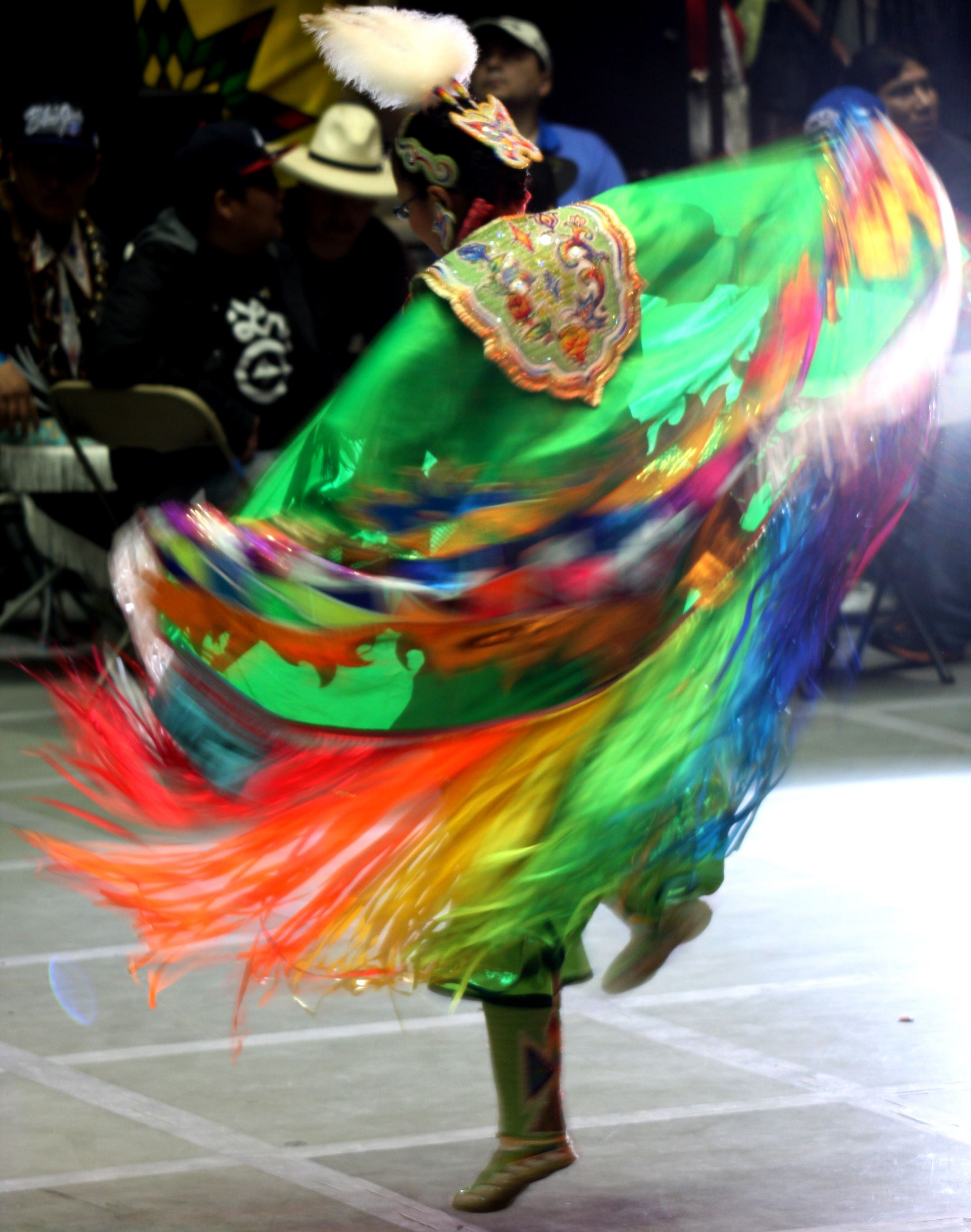 Dancer dressed in brightly colored clothing