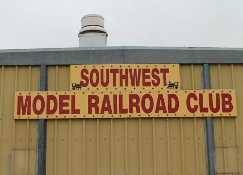 Red and Yellow Sign for the Model Railroad Club